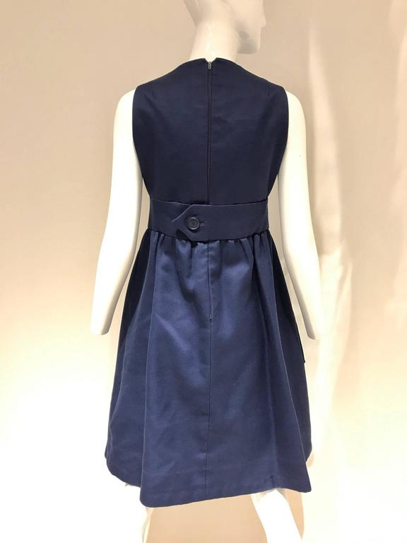Vintage Geoffrey beene navy blue cotton cocktail dress, v neck,  large pocket and inverted pleat. Bust: 35inches/ Waist: 28inches/ Length: 39inches