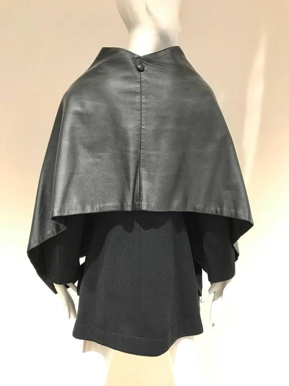 Vintage 1990s Yohji Yamomoto black wool coat with attached leather cape with 2 large pockets.  size 2 fit size 4
