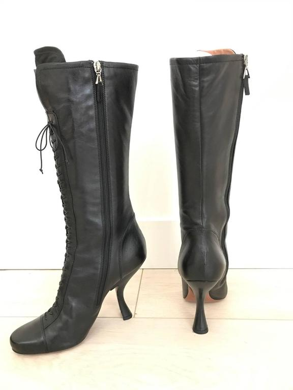 Vintage ALAIA black leather knee boot. Size 39. In great condition Heel height: 4 inch Height of the boots 11.5 inch