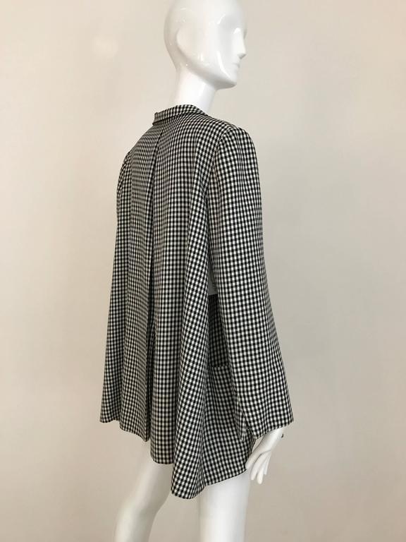 Chic 1976 Christian Dior Couture black and white checkered over coat tent jacket and pencil skirt. Jacket has no closure with 2 oversized pocket with inverted pleats. Jacket and skirt lined in silk. This ensemble is in excellent condition.  Fit US