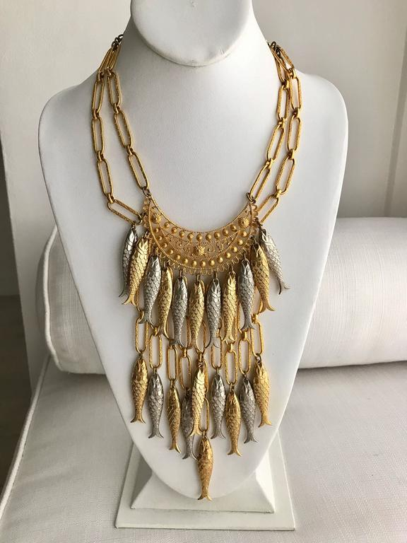 Vintage 1970s Gold and Silver Fish metal bib necklace with clip on earring set. Note: This is not a real gold or real silver, This is a costume jewelry.  Diameter neck : 15.5 inch ( hook is adjustable_ Pendant drop up to : 7 inch  / size of the fish