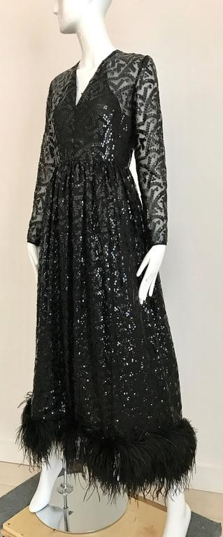 Vintage 1960s BILL BLASS Black V Neck Sequin Gown with Ostrich Feathers In Excellent Condition For Sale In Beverly Hills, CA