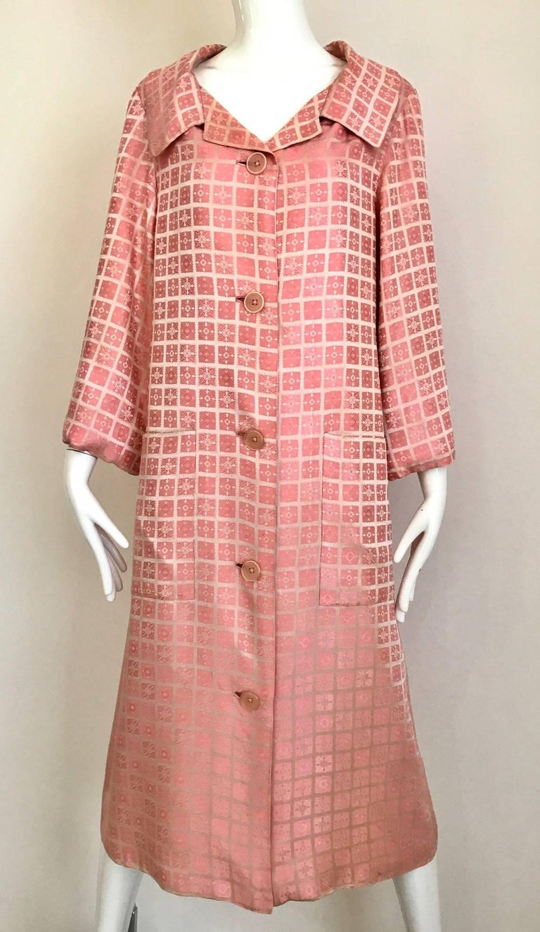 Vintage 1970s  Christian Dior Light Pink mosaic checkered print silk jacquard coat. 2 oversized pockets and silk belt. Coat lined in silk. Size: Medium - Large Bust: 40