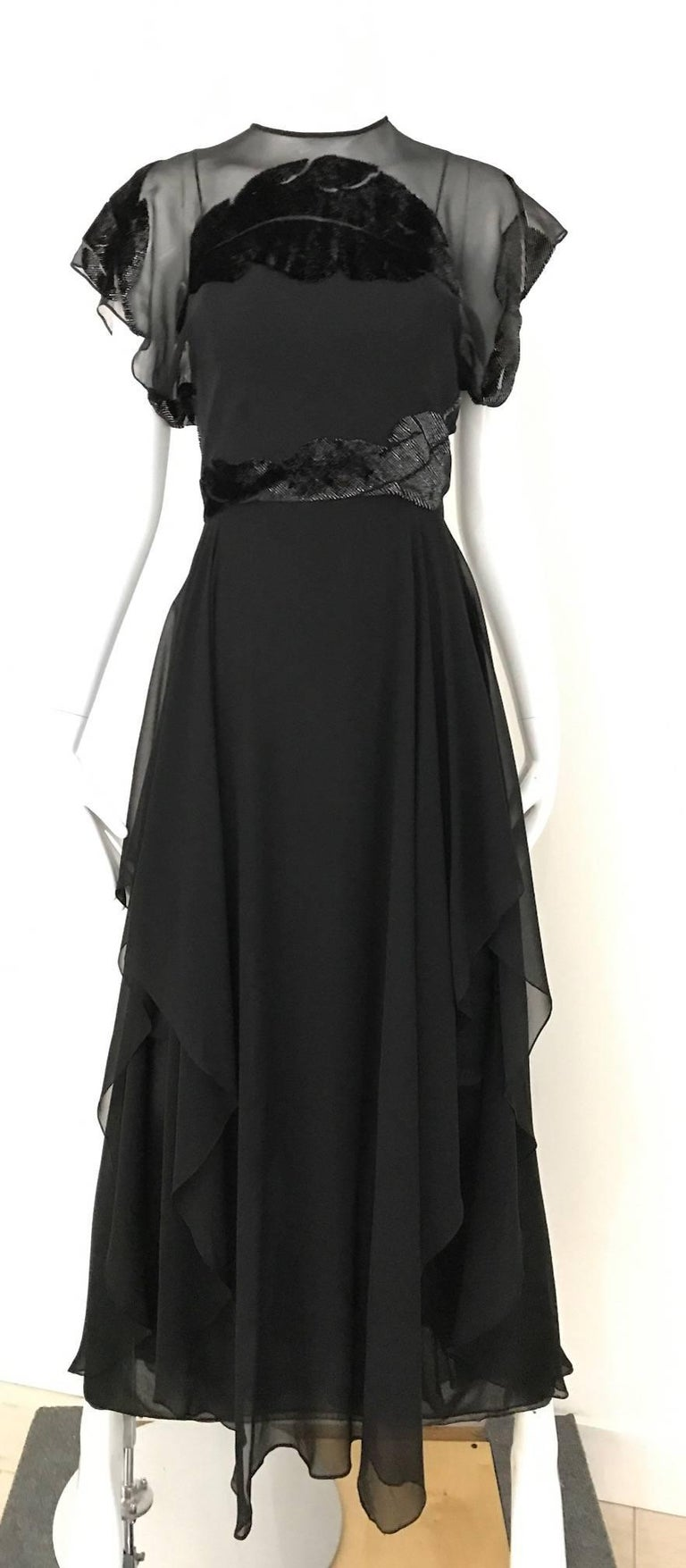 Beautiful Vintage 1970s Neiman Marcus Black Silk Chiffon Dress with overlay velvet cut out leaves  pattern on the bodice and the back. There are three layer of silk chiffon. Size: 2/4 Small Bust: 34 inch/ Waist: 26 inch/ Hip : Open/ Dress Length :