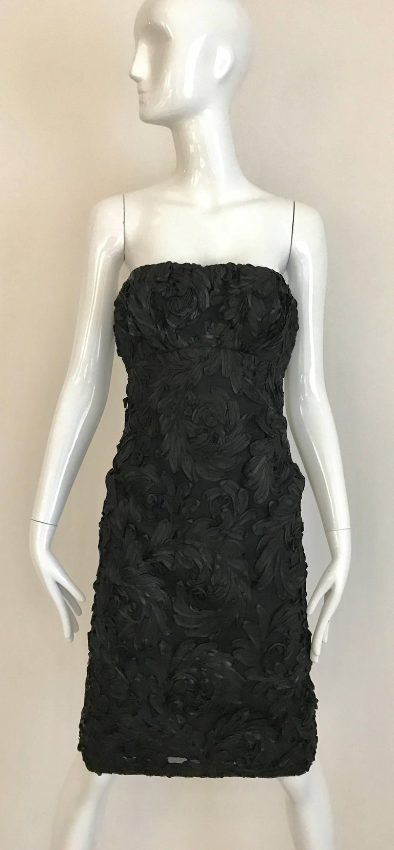 Late 1950s and early 1960s Black Strapless silk lace soutache strapless cocktail dress with Cropped Jacket lined in Mink.  Jacket measurement:  Bust : 36 inch  Dress measurement: Bust: 36 inch / Waist: 25 inch /  Hip 34 inch / Dress Length: 33 inch