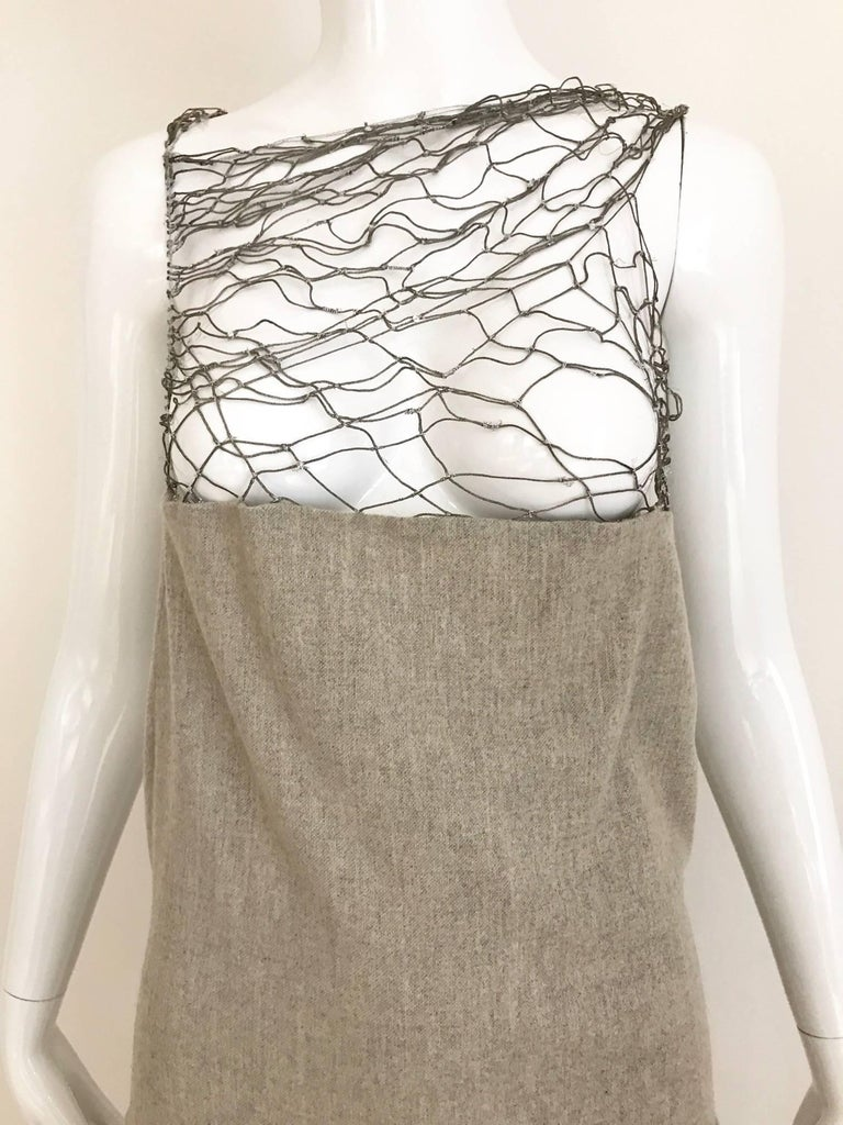 Beautiful Soft Gray Cashmere wool Dress from Narciso Rodriquez. Lattice silver metallic thread on the bust. Slightly A line skirt.  This dress marked size 12 but it fit size 6 or 8 Medium ( see measurement) Bust: 36 inch Waist: 30 inch Hip: 36 inch