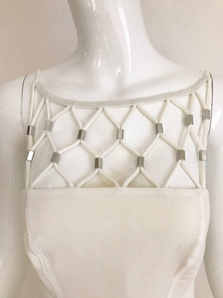 Never Worn Paco Rabanne White Lattice One Piece Bathing Suit. Bathing suit still has store tag. Marked Size 40.  Fit size 4/6 Bust: 32 inch - 34 inch Waist: 28 inch - 30 inch Hip: 34 inch - 36 inch