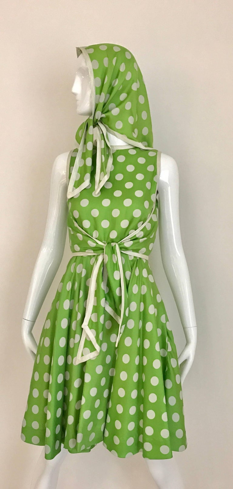 Vintage Early 1960s Teal Traina lime green and white polka dot sleeveless silk dress with scarf/shawl. Dress has belt that attached to wrap in the front. Zip at the back.  Perfect dress for summer cocktail party . Scarf can be also worn as a
