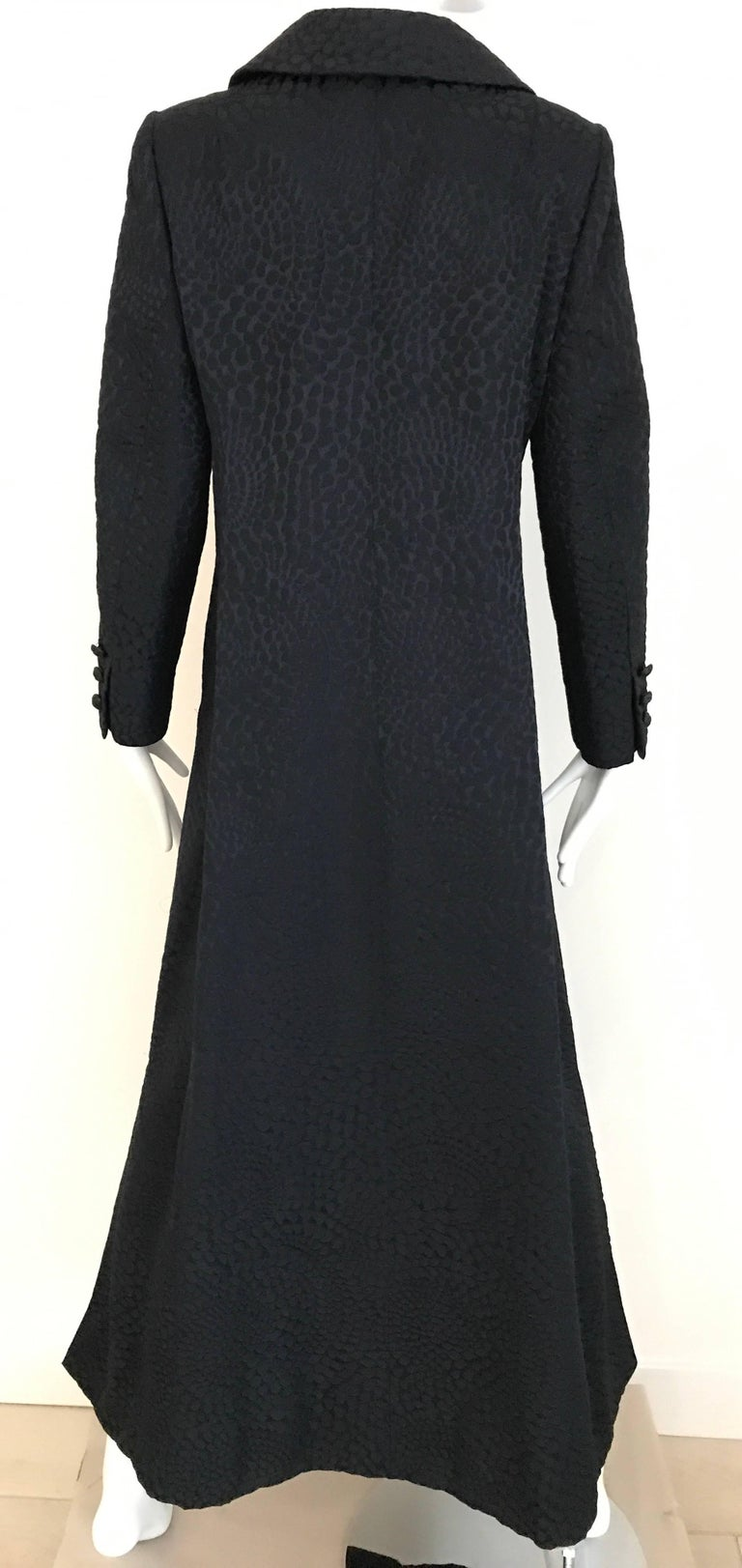 1960s  Black Cotton Jacquard evening  long coat/ Jacket with 2 front pockets.. This coat is in excellent condition and is barely worn. coat is  lined beautifully in silk jacquard. Fitted slimming look. Label: Eres Couture  Size Small - Medium ( 4 /