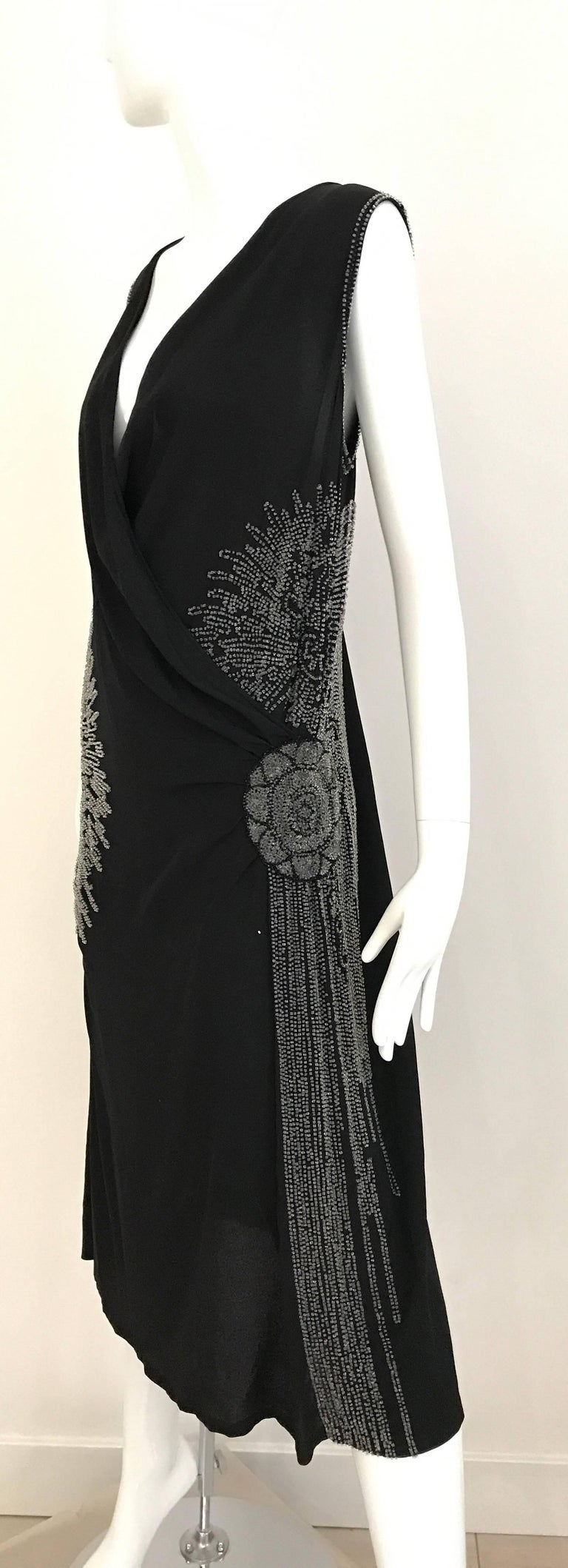Beautiful Large Size 1920s Black Silk V neck sleeveless flapper dress with clear bugle beads beaded in floral pattern. Fit US SIZE 6/8 Bust : 40 inch Waist: 34 inch Hip: 42 inch Length 44 inch