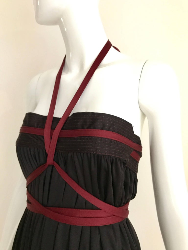 Vintage Geoffrey Beene Qiana Brown burgundy red knit strapless dress with long sash.  Dress can be worn as a maxi skirt. Dress has hidden pocket. Skirt is styled with Gianfranco Ferre Knit top available at my 1stdibs store Fit most sizes from