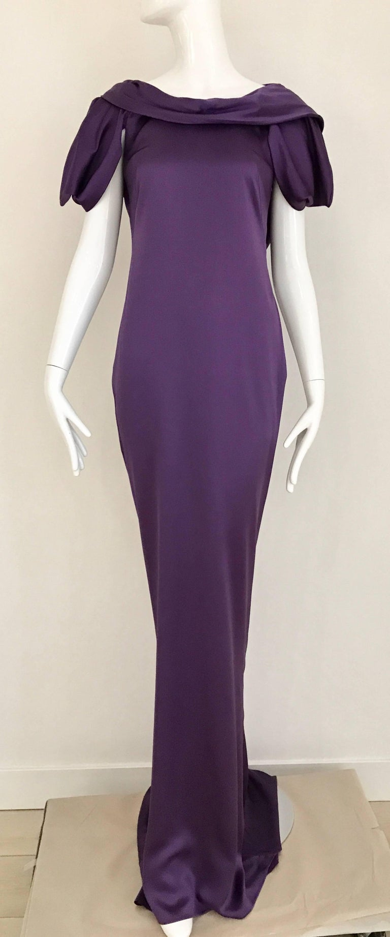 Stunning Alexander McQueen Purple violet silk charmeuse gown with interesting sleeves and exposed bare back. Slightly cowl neck. strap can be removed. Dress zip from the side.  Size Medium / 6 Bust: 36 inch ( back is open) / Waist: 30 inch Hip: 36.5