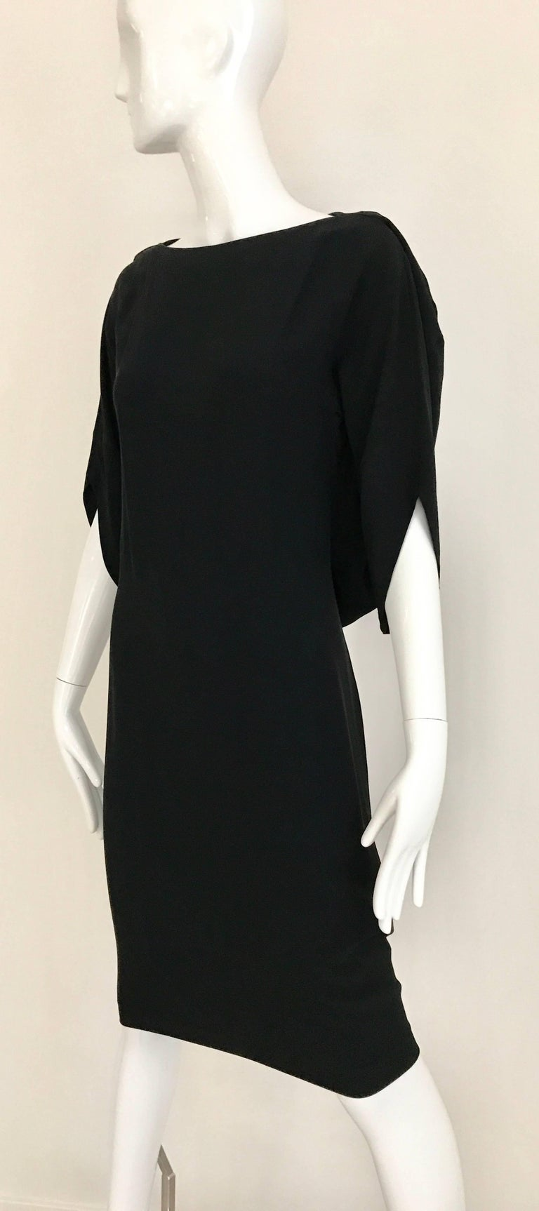 Vintage Margiela Black Rayon dress with interesting sleeves.  Marked size 40 Bust: 34 inch / Waist 26 inch - 32 inch / hip 36 inch / Dress Length: 43 inch