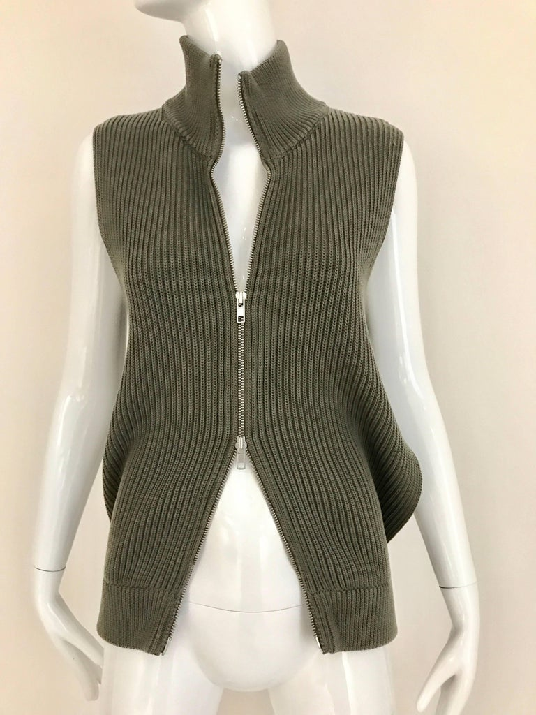 Margiela olive green vest cardigan knit top with double zipper in the front and cut out from the side.  Bust: 34 inch - 36 inch unzipped Waist: 30 inch / Vest  front Length: 24 inch - back length 26 inch