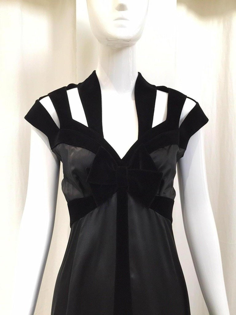 1990s THIERRY MUGLER Black Satin Charmeuse Gown with Cut out Velvet Shoulder.  Black Velvet Bow and cut out shoulder at the back. Perfect evening gown for black tie party. Size 6/ Medium mark size :40   Bust 36 inches  / Waist 28 inches **** This