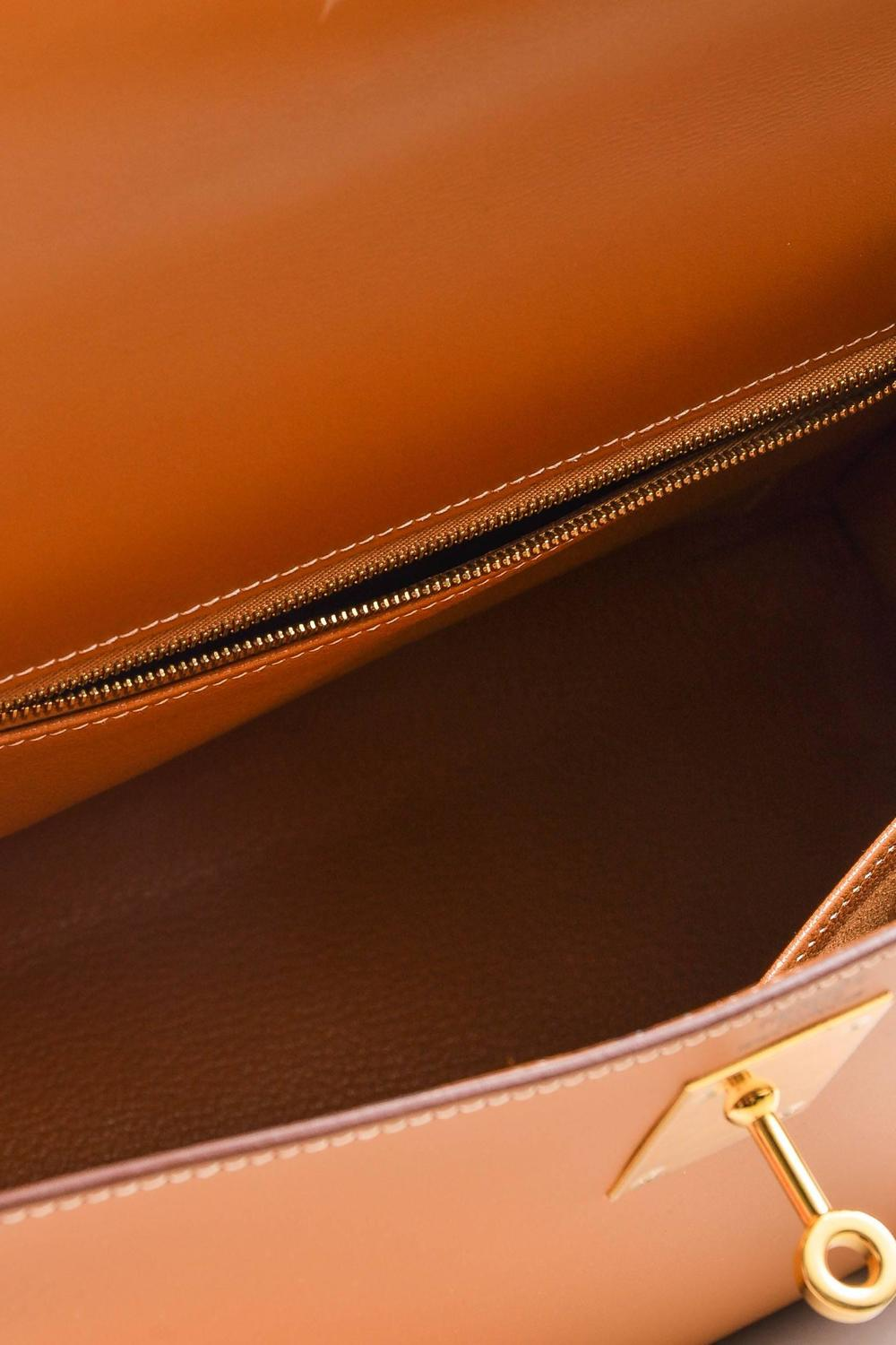 tan leather hermes bag with an h