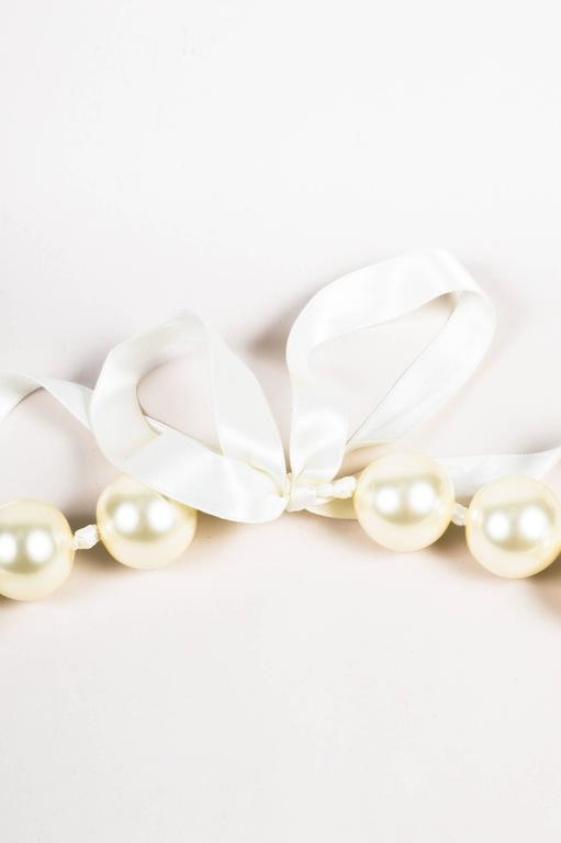 louis vuitton fall 06 runway cream faux pearl oversized satin ribbon necklace for sale at 1stdibs