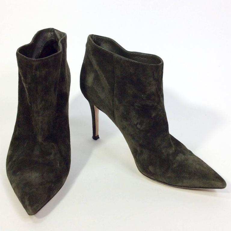 Olive Suede Pointed Bootie 3.5 inch heel 3 inch sole width Pointed toe Decorative seaming on either side of ankle Minor wear on inside of heels Size 37.5 (equates to a US 7) Green suede with leather lining