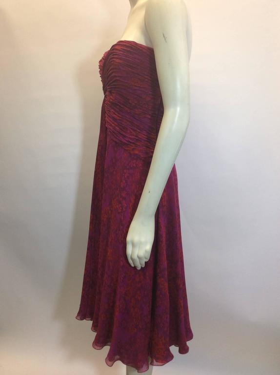 Pink Print Rouched Midi Dress Features interior boning and underwire Side zipper closure with corset hooks Slightly ruffled hem, with raspberry colored lining Size 8 100% Silk