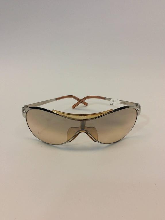 Christian Dior Metal Golden Sunglasses Made in Austria Christian Dior logo embellished on corners $208 Golden lenses