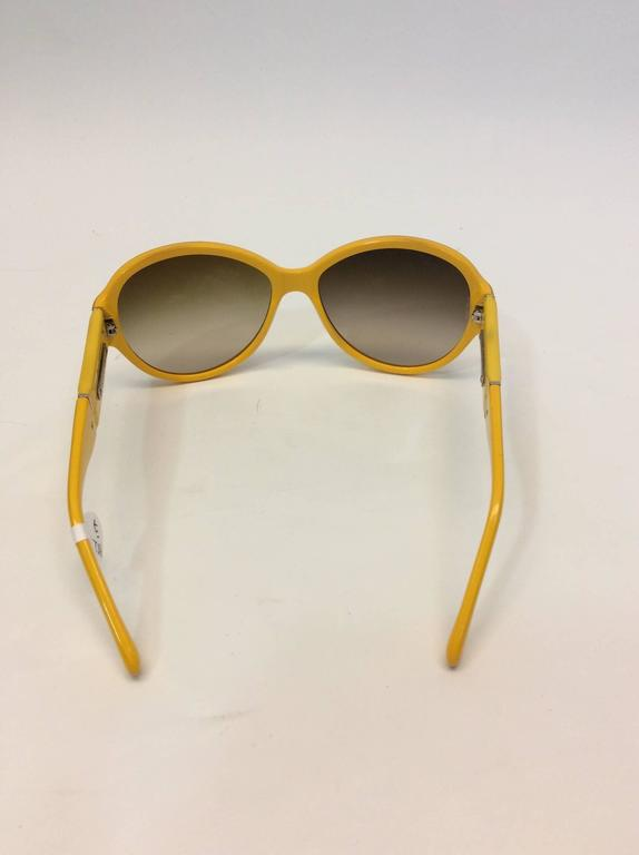 Chanel Yellow Framed Glasses with White Logo Inlay In Excellent Condition For Sale In Narberth, PA