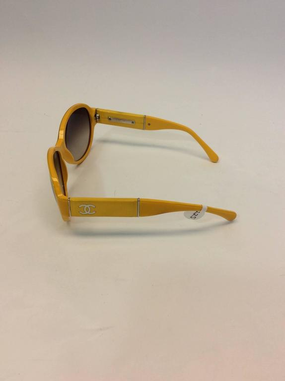 Brown Chanel Yellow Framed Glasses with White Logo Inlay For Sale