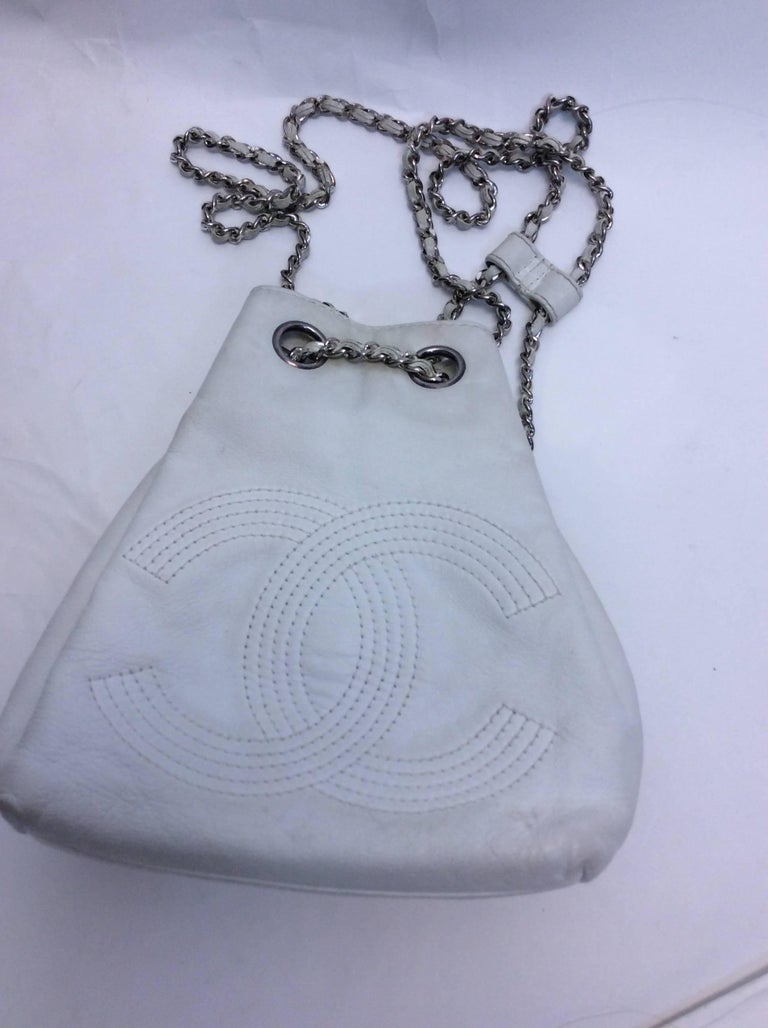 Chanel White Small Vintage Backpack CC logo stitched in center of backpack Silver chain backpack straps with leather center for adjustment  *Condition is fair: Pen marks on inside and staining on exterior. Please reference photos Comes with coin