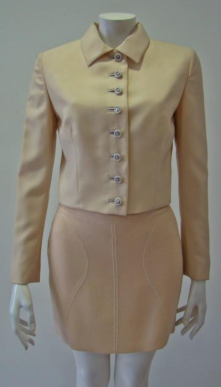 Gianni Versace Couture Cool Wool Creme Short Jacket Featuring Front Fabric Covered Buttons With Silver Medusa Detail, Unfuctional Buttons At Cuffs And A Normal Collar. A Must Have Piece In Your Wardrobe Which Can Easily Be Worn With Any Outfit.