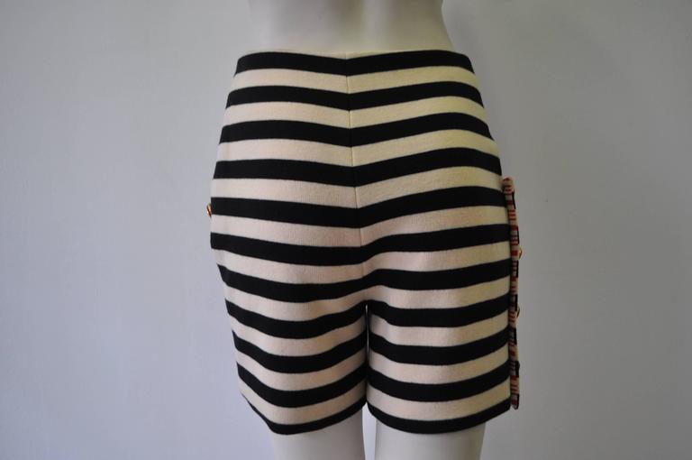 Rare Atelier Versace Nautical Navy and Cream Wool Jersey Striped Shorts.  The shorts feature a row of gilt metal and ruby paste buttons to one side and to one pocket.  Dramatically lined with red and white striped silk crepe they are from the Spring
