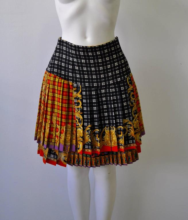 Gianni Versace Couture Tartan Pleated Wool Blend Skirt interspersed with the Iconic Medusa image and layered baroque print from the notorious Bondage Collection Fall 1992