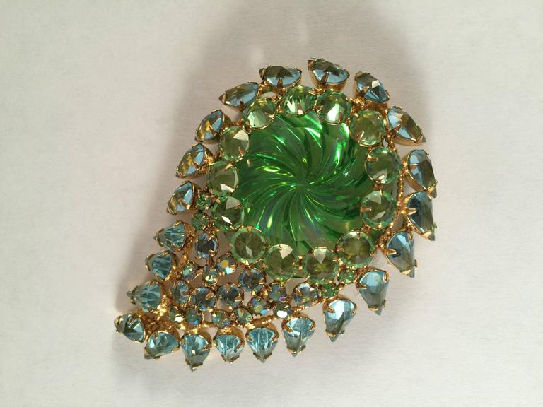 """This 1960s Schreiner New York paisley brooch is a stunner. It measures 2 3/4"""" long x 2"""" wide. It incorporates shades of green and blue. It is set with the stones pointing out (pointy side out instead of down) as was Schreiner's signature. It is"""