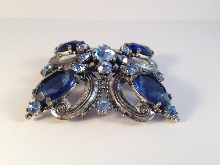 Schiaparelli Brooch and Earrings 1940s Silvertone and Blue Stones  In Excellent Condition For Sale In Chicago, IL