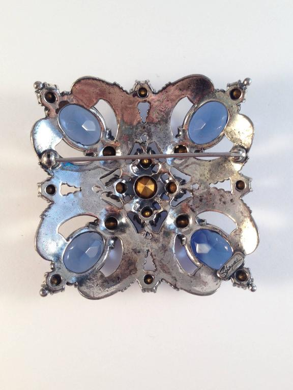 Women's Schiaparelli Brooch and Earrings 1940s Silvertone and Blue Stones  For Sale