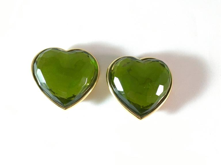This is a pair of fabulous Yves Saint Laurent green glass heart clip-on earrings from the 1980s. They are signed 'Made in France' on the back of the earrings and 'YSL' on the back of the clips. The clips are strong and the earrings are in excellent