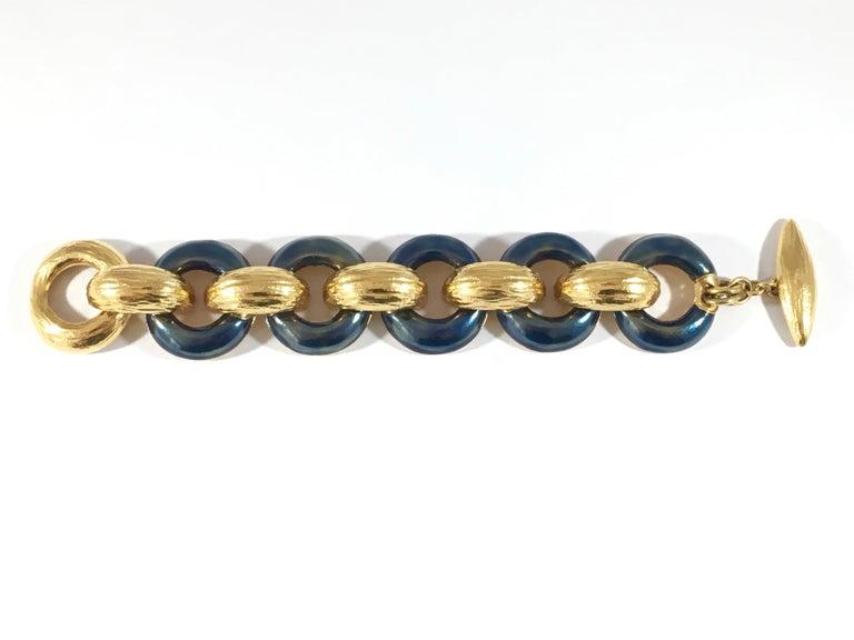 Yves Saint Laurent Goldtone and Bluish Gray Enamel Rive Gauche Bracelet, 1980s  For Sale 1