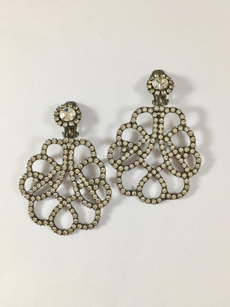 This is a pair of large 1960s Kenneth Jay Lane clip-on earrings. Each earring measures 2 3/4 inches long x 1 7/8