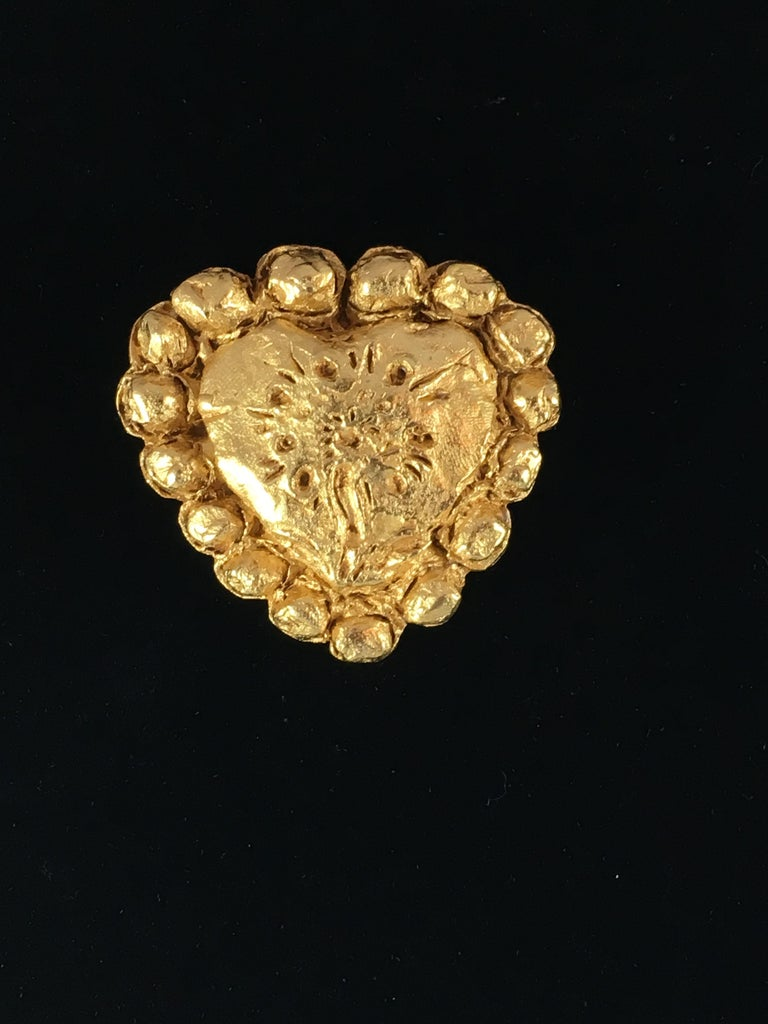This is a goldtone Christian LaCroix heart brooch from the 1990s. It measures 1 7/8 inches long x 2 inches wide and is marked 'Christian LaCroix Made in France' on the back. It is in excellent condition.