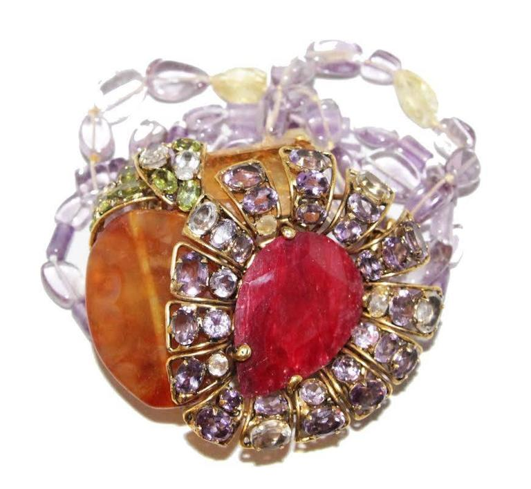 Gorgeous semi-precious bracelet. Adjustable brooch. Signed C&D, 925, vermeil. Made in amethyst, citrine, peridot & aghate.   Excellent vintage condition. Bracelet size : 20 x 5 cm -  7.9 x 2 in. - Brooch size : 7.5 x 6.5 cm - 3 x 2.6 in.