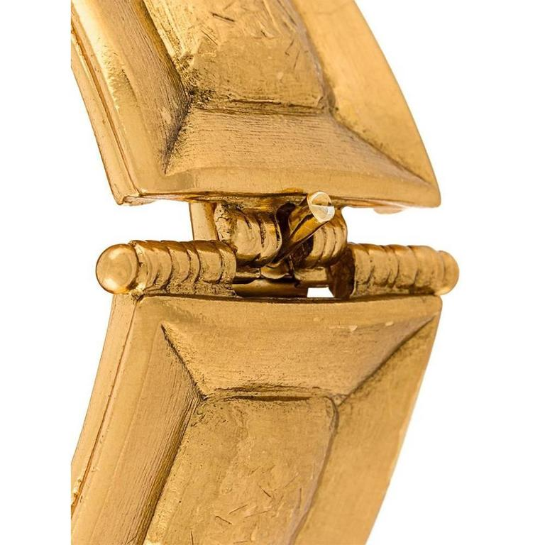 French Art jewelry, Jean-Louis Scherrer hammered square bracelet. Made of gilt metal.  Marked : Scherrer Paris Made in France  Size : circumference: 16.5 cm - 6.5 in., width: 3.3 cm - 1.3 in.   Excellent vintage condition.