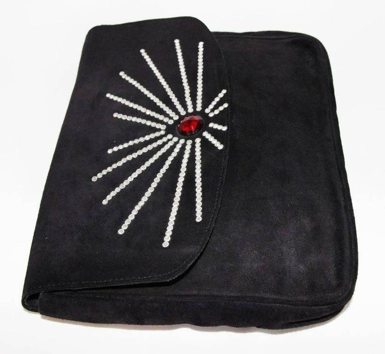 Gorgeous collector piece of Sonia Rykiel. Rare glamour evening clutch. Made of black suede and crystal stones. 80s.   Marked : Made in France Sonia Rykiel Paris   Size : 28 x 21 x 3 cm - 11 x 8.3 x 1.2 in.   Very good condition (some light