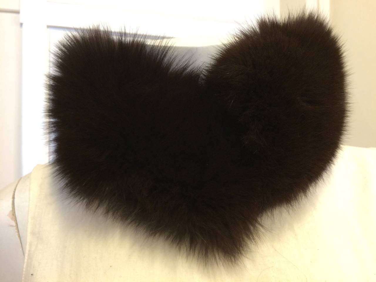 No matter what you're wearing, a deep brown fox fur neck piece adds a luxurious touch. This one by Prada is ultra silky and cozy, yet at the same time glamorous and chic. Wear with a heavy knit sweater and jeans for a more casual look or instead of