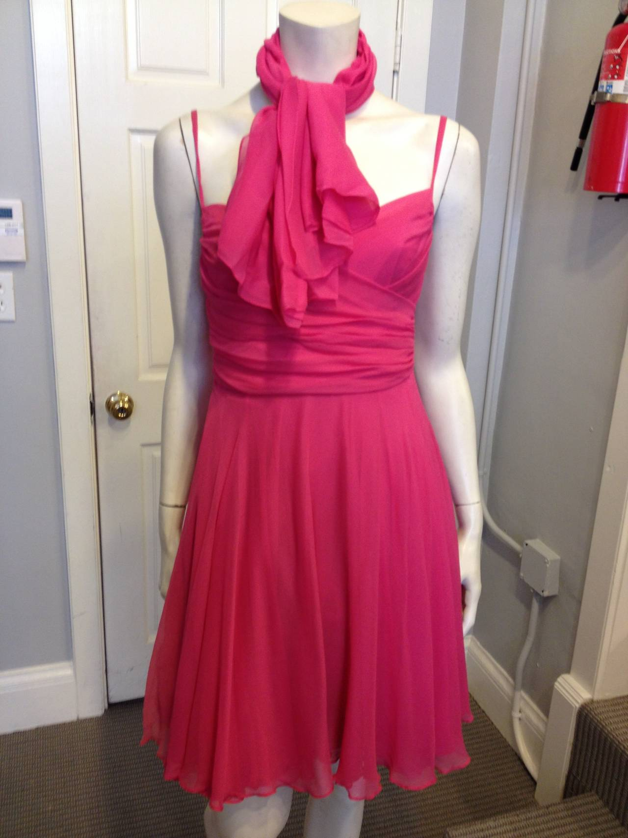 French designer Sophie Sitbon makes such fun dresses! In a saturated candy pink - a color that is bright enough to be girly and sweet, but deep enough and with enough dimension to stay modern - this piece is perfect for a summertime wedding, a
