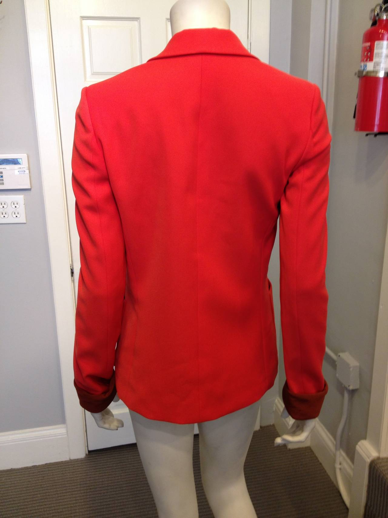 The color of this Balenciaga blazer is so vibrant and energetic! The tailoring is impeccable, with seams down either side to give the piece shape, and with two flat hip pockets. The hem in front is cut at a slight curved angle on either side,