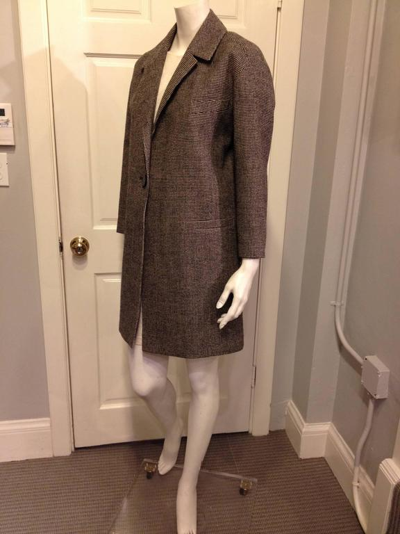 The classic 60s car coat is such an enduring and elegant style - cut wide with tailored shoulders and roomy sleeves, it's the perfect outer layer. The masculine suiting material is gorgeous, a small scale houndstooth of black on mushroom brown to