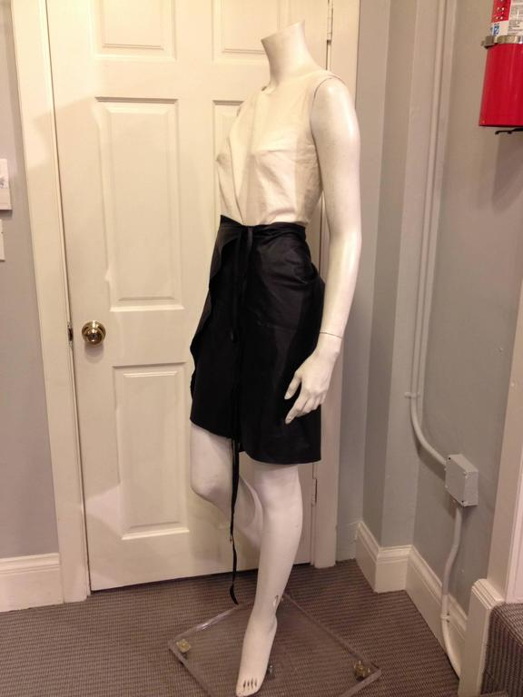 Raw and austere, this Ann Demeulemeester wrap skirt has such an organic minimalism. The leather is thin, lightweight, and flexible, making it easy to wrap however you like - the ties on either side are long enough to wrap twice or hang down. Each