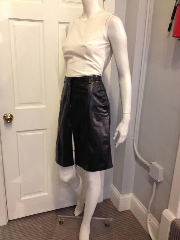 Tough, cool, and feminine all at once, this skirt by Ann Demeulemeester is effortless. The waistline sits high to accentuate the a-line silhouette, and the front is slit several inches high from the hemline. This piece is rock and roll and beautiful