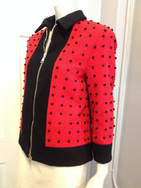 This Givenchy jacket has literal star power. A runway piece from the Autumn 2012-2013 menswear collection (look 39), it's so rock n roll - the bright red fabric is studded with a grid of three-dimensional prong-set star-shaped black rhinestones. The