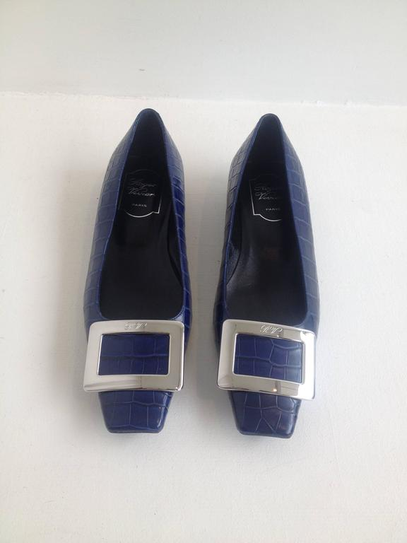 We love the way that even the most classic Roger Vivier flats always feel so current. These are timeless but simultaneously  edgy - the crocodile look is luxurious, while the eye-catching bright blue feels fresh and young. The square toe is totally