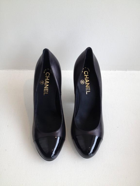 A four inch block heel updates these super classic Chanel pumps in the perfect way. The silhouette is both cool and modern while easy to run around in all day. The super soft leather has a tiny stitched double C on the outside of the heel and the