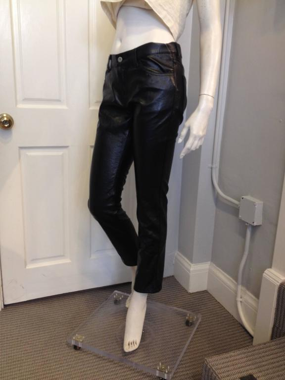 Super shiny crinkly fabric lends an very cool look to these jeans - edgier than your average leather pant, the resin-coated fabric has a textured patent-like finish. These have a straight leg and a cropped hemline, with a low-rise waistline and